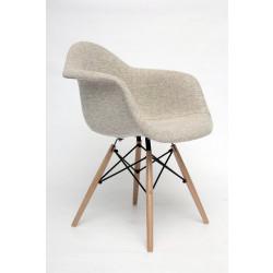 NORDISK Design Armlehnstuhl mit beige gepolstertem Schalensitz aus Webstoff